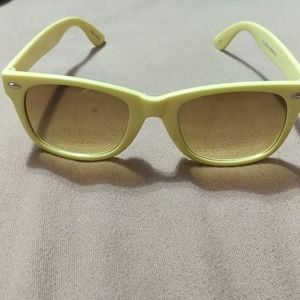 Light yellow sunglasses by Claire's